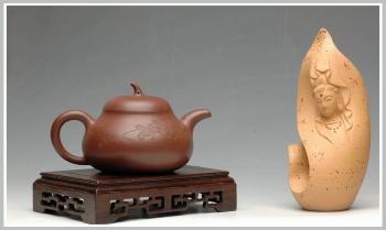 紫砂壶图片:【瑕疵特价】优雅之风 和石刻绘潘天寿兰花盘 全手紫泥茄段 - 宜兴紫砂壶网