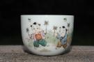 紫砂壶图片:双人童子风筝 景德镇主人杯 - 宜兴紫砂壶网